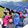 John P. Cleary |  The Herald Bulletin<br /> Jack Alvey, senior vice president of generation for IMPA, answers questions from these Erskine Elementary School 4th graders while giving them a tour of the new Anderson 1 Solar Park Tuesday. 50 local elementary school students  were invited to take part in the official opening of the solar park and tour the new facility. The students have been studying about renewable energy in their classes.