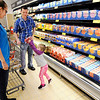 Don Knight | The Herald Bulletin<br /> Tori and Josh Peterson look on as their daughter Loralye puts some cheese in their shopping cart during ALDI's reopening on Thursday.