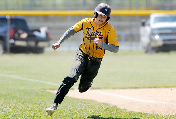 Don Knight   The Herald Bulletin<br /> Alexandria's Trey Stokes rounds third headed for home as the Shenandoah Raiders hosted the Tigers for a doubleheader on Saturday
