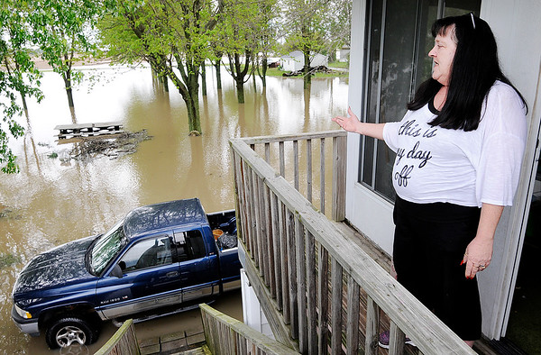 Don Knight | The Herald Bulletin<br /> Cindy Friesen looks out over her flooded property on County Road 600 West on Friday.