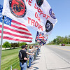 Don Knight | The Herald Bulletin<br /> Flags line the stop for Sgt Tristan M. Wade and Cpl Todd Hawk on Ind. 32 in front of the Rozelle-Johnson Funeral Home during the Indiana Run for the Fallen on Saturday.
