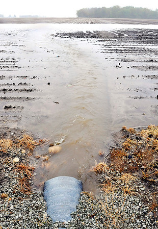 John P. Cleary    The Herald Bulletin<br /> This drainage pipe gushes with water from all the rainfall into this freshly planted farm field along County Road 375 North near CR 200 West Thursday afternoon.