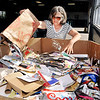 John P. Cleary |  The Herald Bulletin<br /> Karen Wright, of Frankton, dumps a bag of paper items into the bin at the Madison County Recycling Center Tuesday for recycling.