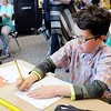 Don Knight | The Herald Bulletin<br /> Kaleb Dean works on an assignment at Eastside Elementary on Friday. students who had a perfect score on the iREAD test. Eastside had 8 students get perfect scores on the iREAD-3 test.