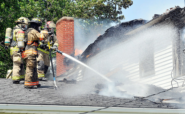 John P. Cleary |  The Herald Bulletin<br /> Firefighters from multiple area departments battled a house fire Thursday afternoon that heavily damaged a 183 year-old farmhouse in the 1000 block of Indiana 38 Thursday afternoon.