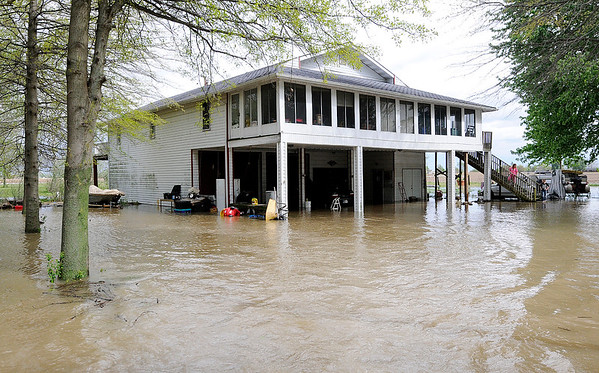 Don Knight | The Herald Bulletin<br /> Cindy Friesen's home on County Road 600 West is inundated with flood water.