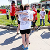 Don Knight | The Herald Bulletin<br /> Anita Walker hugs participants in the Indiana Run for the Fallen during a stop on Scatterfield to honor Walker's son Sgt Robert E. Colvill  and Lance Cpl Alec R. Terwiske on Saturday. Sgt. Colvill was from Anderson and served eight years in the Marine Corp before joining the Army.