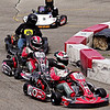 Mark Maynard | for The Herald Bulletin<br /> Nose-to-tail kart racing action during the Mayor's Cup Grand Prix presented by the Anderson Sertoma Club at the Mounds Mall.