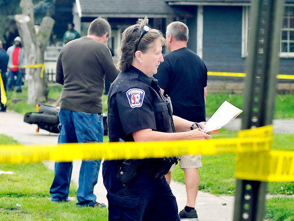 John P. Cleary |  The Herald Bulletin<br /> Anderson police officers work the scene of Tuesday evening's shooting in the 1700 block of Jefferson Street that left one man dead.