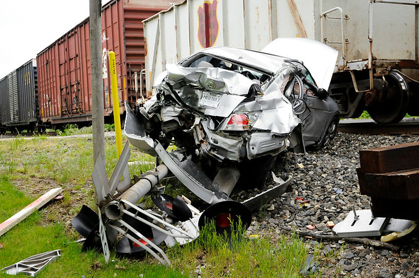 Don Knight   The Herald Bulletin<br /> No one was injured after a train hit a car in the crossing on Rangeline on Thursday afternoon.