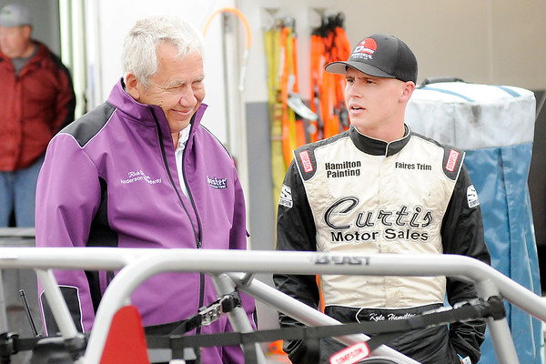 Don Knight   The Herald Bulletin<br /> Anderson Speedway owner Rick Dawson talks to driver Kyle Hamilton in the pits during practice for the Little 500 on Thursday.