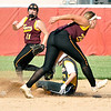 John P. Cleary |  The Herald Bulletin<br /> Alexandria's shortstop Mackenzie McCarty tries to tag Monroe Central runner Lauren Yates as she slides into second with a stolen base as Alexandria's Kirsten VanHorn backs up the play.