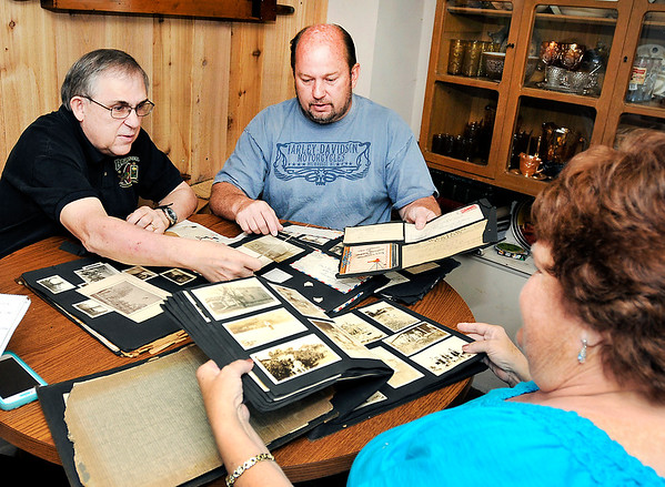 John P. Cleary    The Herald Bulletin<br /> Greg Frolke goes over photos and letters belonging to his father Darrell Frolke during WWII with Richard Petty who got them from an old storage locker he bought at auction than tracked down the family. Frolke's wife Debbie, right, looks over one of the photo albums.