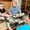 John P. Cleary |  The Herald Bulletin<br /> Greg Frolke goes over photos and letters belonging to his father Darrell Frolke during WWII with Richard Petty who got them from an old storage locker he bought at auction than tracked down the family. Frolke's wife Debbie, right, looks over one of the photo albums.