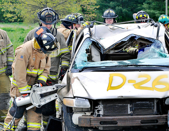 "John P. Cleary |  The Herald Bulletin<br /> Students from Anderson Community Schools' D26 Career Center fire and rescue class use the jaws-of-life to extricate ""accident victims"" as they participate in a mock vehicle accident training exercise Wednesday as part of their schooling."