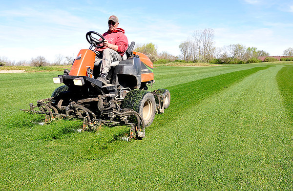 John P. Cleary |  The Herald Bulletin<br /> Steve Fuller mows the #1 fairway at Elwood Golf Links recently as work continues for the course's grand reopening May 6th.
