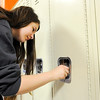 Don Knight | The Herald Bulletin<br /> Siarah Majors practices opening a locker as sixth graders get a tour of the Madison-Grant Junior High on Friday.