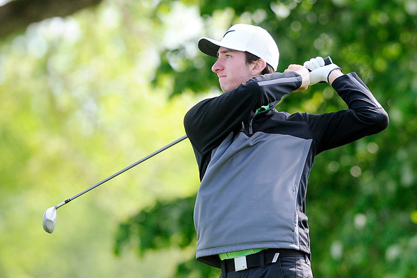 Don Knight | The Herald Bulletin<br /> Pendleton Heights' Curtis Patterson watches his tee shot on the third hole at Grandview during the County golf tournament on Monday.