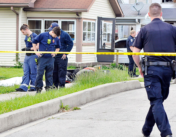 John P. Cleary |  The Herald Bulletin<br /> Anderson police and medics check over the scene of a shooting in the 1700 block of Jefferson Street that left one person dead Tuesday evening.