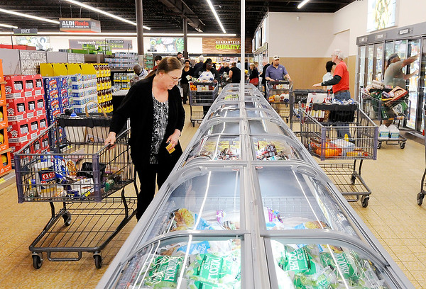 Don Knight   The Herald Bulletin<br /> Darlene Deck looks in the freezer section as ALDI opened their remodeled store on 53rd Street on Thursday.