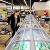 Don Knight | The Herald Bulletin<br /> Darlene Deck looks in the freezer section as ALDI opened their remodeled store on 53rd Street on Thursday.