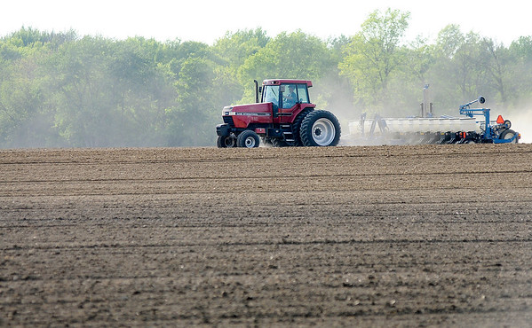 Don Knight   The Herald Bulletin<br /> A farmer plants a field along County Road  300 West on Tuesday. Farmers are trying to make up for lost time after a soggy start to the month of May.