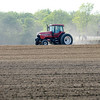 Don Knight | The Herald Bulletin<br /> A farmer plants a field along County Road  300 West on Tuesday. Farmers are trying to make up for lost time after a soggy start to the month of May.