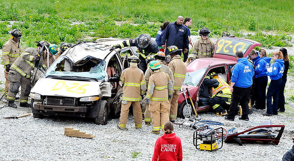 John P. Cleary |  The Herald Bulletin<br /> Students from Anderson Community Schools' D26 Career Center fire and rescue class, EMT class, and criminal justice class collaborate together as they<br /> participate in a mock vehicle accident training exercise Wednesday.