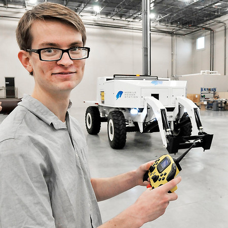 John P. Cleary |  The Herald Bulletin<br /> Dakota Welker served an internship with DD Danner and worked on their mobile power station project, which he controls here remotely. Welker will give the graduation speech for the first graduation class for Purdue Polytechnic.