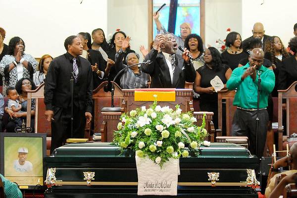 "Don Knight | The Herald Bulletin<br /> Pastor Edgar Woodall sings ""The Lord Will Make a Way Somehow"" during the funeral for Montez McCloud at Friendship Missionary Baptist Church on Friday."