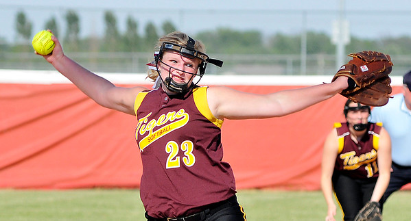John P. Cleary |  The Herald Bulletin<br /> Alexadria's pitcher Kaitlyn Davis lets loose with a pitch against Monroe Central.