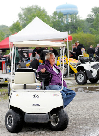 Don Knight   The Herald Bulletin<br /> Anderson Speedway owner Rick Dawson drives his golf cart around the pits during practice for the Little 500 on Thursday.