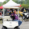 Don Knight | The Herald Bulletin<br /> Anderson Speedway owner Rick Dawson drives his golf cart around the pits during practice for the Little 500 on Thursday.