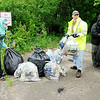 Don Knight | The Herald Bulletin<br /> Volunteers filled several bags with trash picked up along the White River East of Scatterfield on Saturday. The effort had to be cut short as Thunderstorms moved through the area.