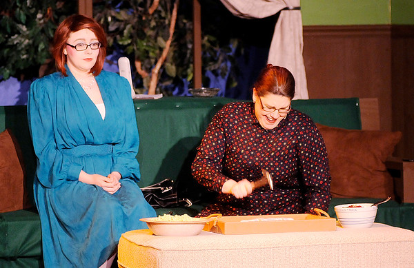 "Don Knight | The Herald Bulletin<br /> Clelia Waldgrave (Angela Gick) smashes a saucer to relieve stress as Tansy McGinnis (Aleia Short) looks on in Mainstage Theatre's production of ""The Nerd."""
