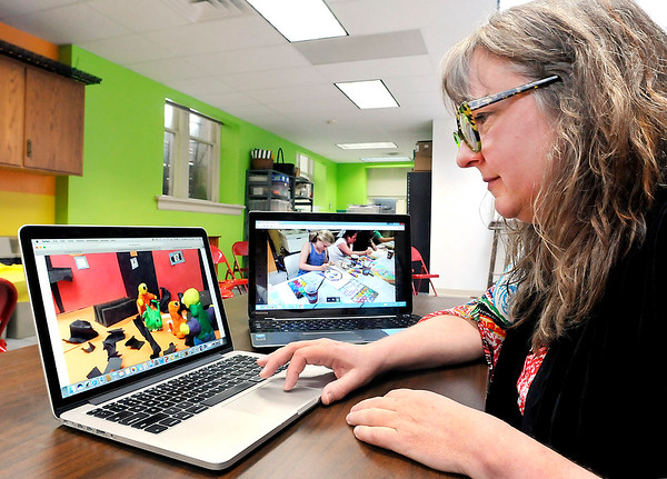 John P. Cleary |  The Herald Bulletin<br /> Stephanie Cochran, education coordinator at Anderson Center for the Arts, works on this year's summer art camps. This years camps will include 3D sculpture, animation, drawing, painting, and print making, and a ceramics camp.