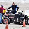 John P. Cleary |  The Herald Bulletin<br /> Michigan driver Doug Dietsch gets congratulations from track personnel Friday after riding out being on the bubble for the last part of qualifying to make the Little 500 starting 33rd.