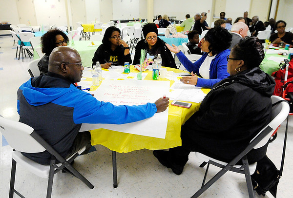 Don Knight | The Herald Bulletin<br /> Group discussions about ways to improve the quality of life in the neighborhood defined by the 46016 zip code at the Anderson Impact Center on Thursday.