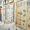John P. Cleary |  The Herald Bulletin<br /> Jim Roof, grandson of Robert Roof, looks over promotional posters from his grandfather's businesses, Laurel Motors and R&R Manufacturing.