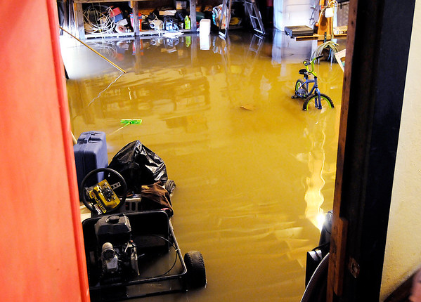 Don Knight | The Herald Bulletin<br /> The garage of Cindy Friesen's home is flooded on County Road 600 West. She lives there with her daughter and grandchildren.
