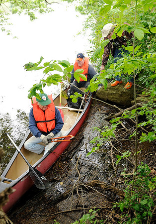 Don Knight   The Herald Bulletin<br /> Bob Whited picks up a discarded smokeless tobacco can during cleanup<br /> efforts around Shadyside Park on Saturday. Michael Kippen was in the canoe with Whited and Bill Evans was helping from the shore.