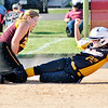 John P. Cleary |  The Herald Bulletin<br /> Alexandria's Haley Johnson tries to block third base as Monroe Central's Mabrey Buis slides into the bag trying to stretch a double into a triple in the 4th inning. The runner was called safe on the play.