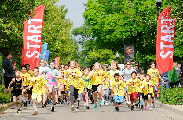 Don Knight   The Herald Bulletin<br /> Kids take off at the start of the St. Vincent-YMCA Kidz Marathon at Anderson University on Saturday.