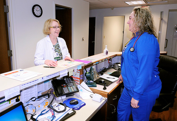 Don Knight | The Herald Bulletin<br /> Dr. Nancy Wozniak, at the St. Vincent Medical Group location in Alexandria, talks with Haylie Williams, LPN.