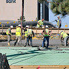 John P. Cleary | The Herald Bulletin<br /> Workers started to pour concrete on the east half of the west-bound lanes of the Eisenhower Bridge, laying down more then 425 yards of concrete Monday morning.