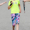 Don Knight | The Herald Bulletin<br /> Raya Conway, 11, receives her medal at the finish line as she was the second to finish the St. Vincent-YMCA Kidz Marathon at Anderson University on Saturday.
