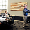 John P. Cleary | The Herald Bulletin<br /> The krM Architecture design team gets together each Friday over lunch to critique projects they are working on. Here architect Kevin Montgomery gives his input on the floor plan they are looking at during their session.