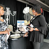 John P. Cleary | The Herald Bulletin<br /> Ann Williams, of Simply Silk by Ann, networks with Sharon Reed, owner of Esther's Place Boutique of Kokomo, during the Madison County Black Chamber of Commerce Business Opportunity and Job Fair Thursday held at Hoosier Park Racing & Casino.<br /> <br /> <br /> <br /> Madison County Black Chamber of Commerce Job Fair at Hoosier Park.