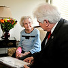 John P. Cleary | The Herald Bulletin  <br /> Margaret Minnick, 103, receives a bouquet of flowers and a plaque from Anderson Mayor Thomas Broderick, Jr. for her 103 years of service to Community and Family Tuesday afternoon at Northview Care Center.