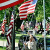 John P. Cleary | The Herald Bulletin<br /> Maplewood Cemetery employee Keith Sherman puts up one of approximately 260 American flags along the lanes of the cemetery Wednesday as the staff prepares for the Memorial Day holiday weekend.